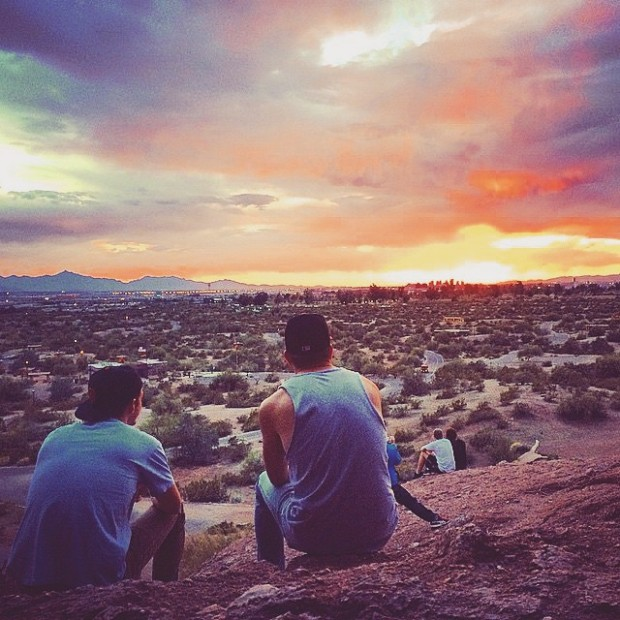 Brothers reunited watching an amazing sunset.