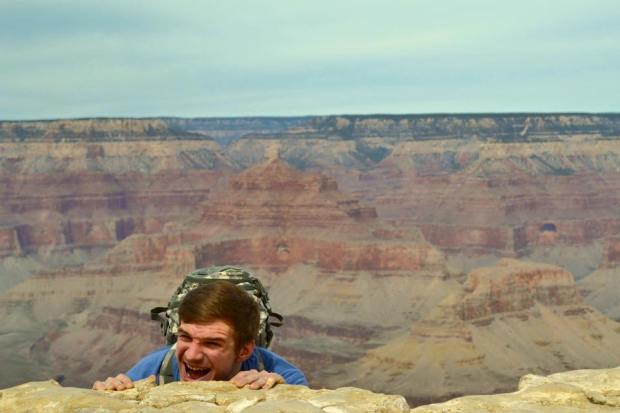 This goofball hanging over the edge.  But how gorgeous is the Grand Canyon?!